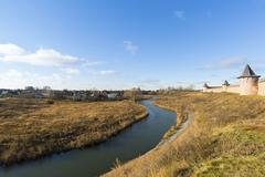 Landscape with  river Kamenka and Wall St. Euthymius monastery in Suzdal, Rus - stock photo