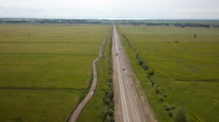 Aerial shot of car on the rural road Stock Footage