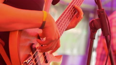 Musician playing a bass guitar in a live concert Stock Footage