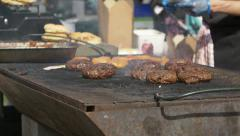 Grilling hamburger on open air: street food Stock Footage