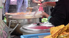 Street food serving on a live event: stand of asian street food Stock Footage