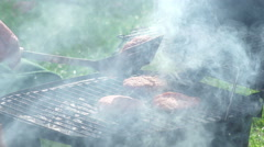 Stock Video Footage of homemade barbeque with hamburger on the grill