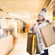 Happy brunette girl in shopping mall Stock Photos