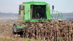 Farm sunflower harvest with John Deere combine Stock Footage