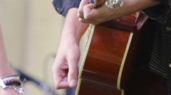 musician playing acoustic guitar in a live concert - stock footage
