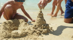 Building sand castle close-up. Stock Footage