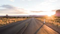 Driving USA: Spectacular sunset driving along lonely road in American desert Arkistovideo