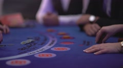 Gambling Black Jack in a casino - counting gaming chips - stock footage