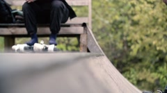 Teen with roller skates performing a stunt on a half pipe ramp Slow Motion 400 Stock Footage