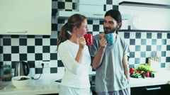 Man and woman drinking morning tea at the kitchen Stock Footage