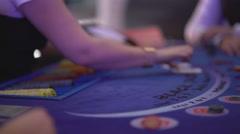 Gambling Black Jack in a casino - dispensing cards - stock footage