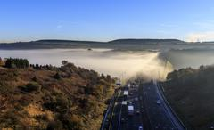 Fog on M62 motorway - stock photo