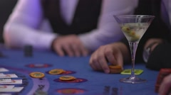 Gambling Black Jack in a casino - Gambler asking for cards - James Bond style Stock Footage