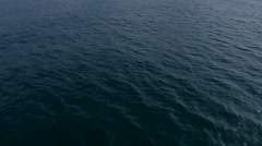 Low angle aerial above the ocean water Stock Footage