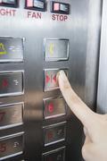 Hand press open door button in elevator Kuvituskuvat