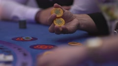 Gambler playing with chips at a Back Jack table Stock Footage