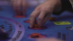 Gambling Black Jack in a casino - making bet with gaming chips - stock footage
