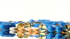 Medical pills, tablets and capsules, rotation, reflection, on white - stock footage