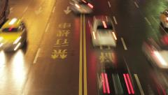 Night time-lapse looking down at traffic on busy city street in Taipei, Taiwan Stock Footage