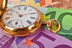 gold pocket watch - stock photo