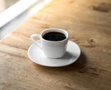 Espresso Coffee cup on wood table - stock photo