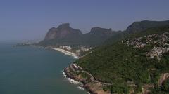 Flying above the Beach of Sao Conrado with Pedra Gavea Mountain, Rio de Janeiro - stock footage