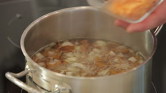 Cooking vegetable soup in a pan Stock Footage