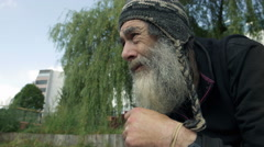 thoughtful old man, sad old man living in the street: homeless  - stock footage