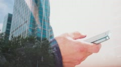 Double exposure, man with cell phone and London office building 4k - stock footage