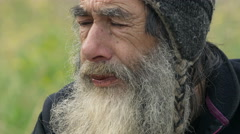 old homeless man living by charity  - stock footage