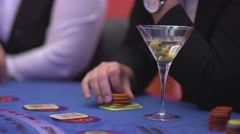 Gambling Black Jack in a casino - nervous gambler with Vodka Martini - stock footage