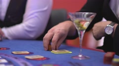 Gambling Black Jack in a casino - nervous gambler waiting for cards Stock Footage