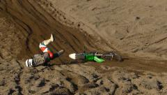 FMX Rider crashes on sandy landing Stock Footage