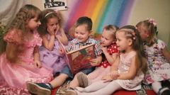 Children sit and look at books. Stock Footage