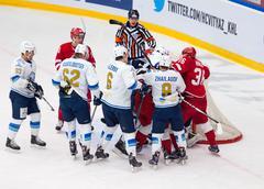 Keaton Ellerby (6) and Talgat Zhailauov (8) attack - stock photo