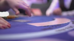 Gambling Black Jack in a casino - dealer spreading cards on a black jack table Stock Footage