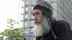 Homeless in the city: closeup portrait, begging man  Stock Footage