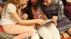 Children play with the tablet. On the wall of children's drawings. - stock footage