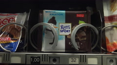 Ritter Sport chocolate purchased from vending machine 4k Stock Footage