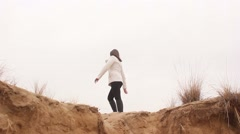 woman girl is back on the precipice sand nature autumn - stock footage