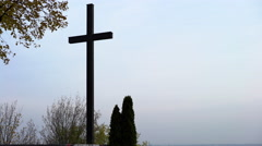 Large cross with dark gray sky in the background 4k Stock Footage