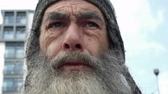 face of a real homeless man living in the streets of an England city  - stock footage