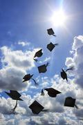 Stock Photo of Degree hat throw in sunshine and blue sky