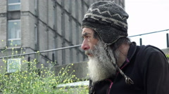 real homeless living in the street and waiting for charity  - stock footage