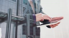 London office building double exposure with businessman touching tablet screen - stock footage