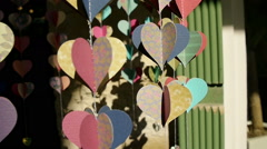 Paper hearts that rotate in the wind Stock Footage