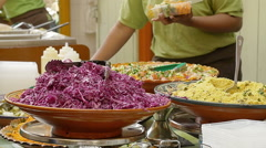 street food: salad, cous cous, humus, falafel, vegetables, meat   - stock footage
