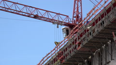 Construction crane at build site of building 4k Stock Footage