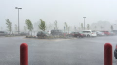 Stock Video Footage of Heavy rain storm with cars in parking lot