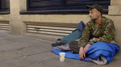 Begging young man in the street  Stock Footage